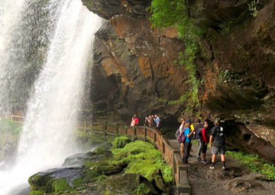 FMU students hike through a waterfall at the Wild Sumaco research station in Ecuador.