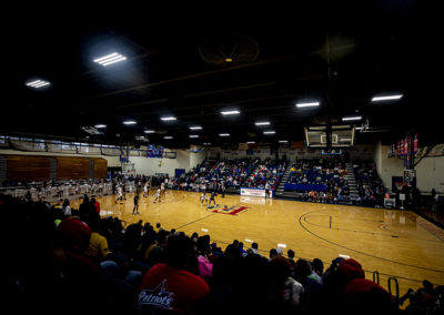 Wide angle overview of game action during the men's homecoming basketball game in 2020.