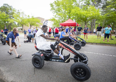 Students participate in pedal cart races during the 2019 Arts International Festival.