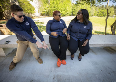 Student Government leaders Gabe Hudson, Connor Graham, and Precious McLaughlin laugh during a photo shoot in 2019.