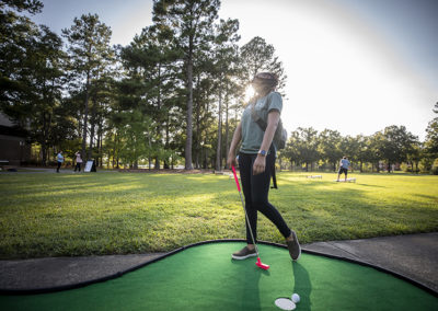 Students enjoy putt putt during a welcome back cookout in 2019.