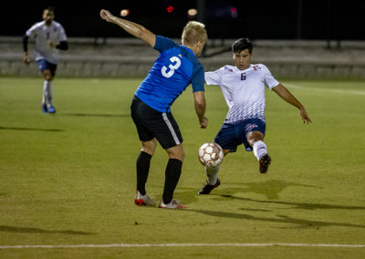 Two men play soccer at FMU's Sparrow Field.