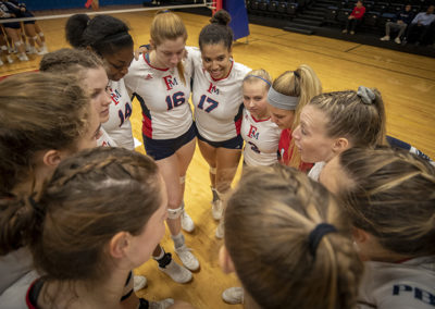 FMU's volleyball team gets ready for a game on October 2019.