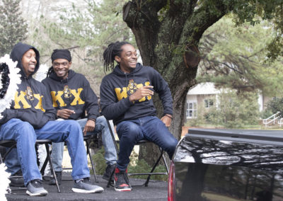 Fraternity brother ride a float during the annual Homecoming events on Saturday February 1, 2020.