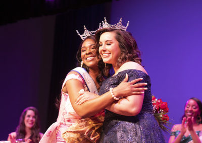 MaQuitta Butler receives a hug from Ms. FMU 2019 Alexa Williamson after winning the 2020 Ms. FMU Scholarship Pageant.