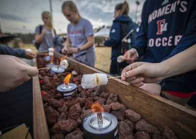Students roast marshmallows during the Homecoming bonfire in February 2019.
