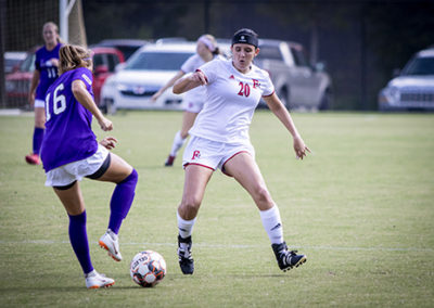 Two women play soccer at Francis Marion University's Sparrow Field.
